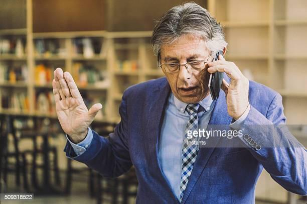 Impatient senior businessman