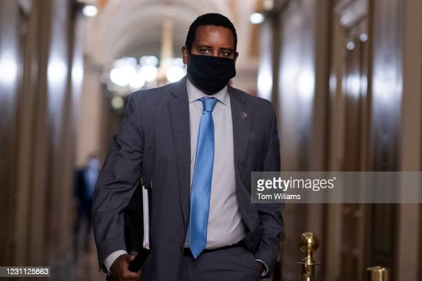 Impeachment manager Rep. Joe Neguse, D-Colo., is seen in the Capitol during a break in the impeachment trial of former President Donald Trump in...