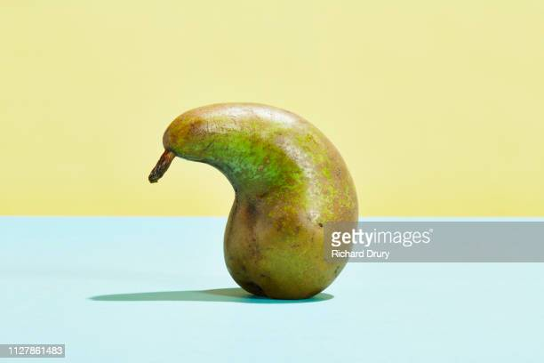 imperfect pear - imperfection stock pictures, royalty-free photos & images