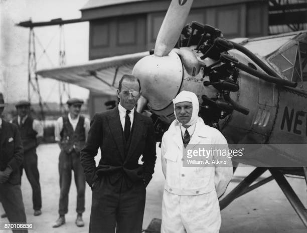 Imperial Airways pilot and former World War I flying ace Walter G R Hinchliffe with Charles Arthur Levine at Croydon Aerodrome in London with the...