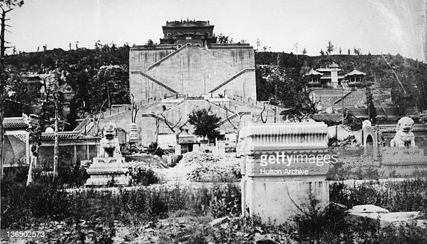 Imperial bronze lion sculptures in the ruins of the Old Summer Palace, Beijing, China, 1869. The Palace, formerly the residence of emperors of the...