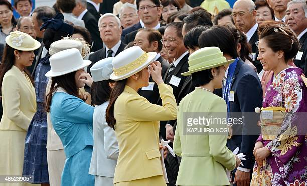 Imperial family members including Princess Kiko and her daughter Princess Mako greet guests during the annual spring garden party at the Akasaka...