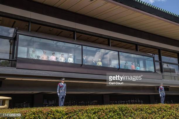 Imperial Guardsman stand next to the balcony as Emperor Naruhito accompanied by his wife Empress Masako and other members of the Japanese royal...