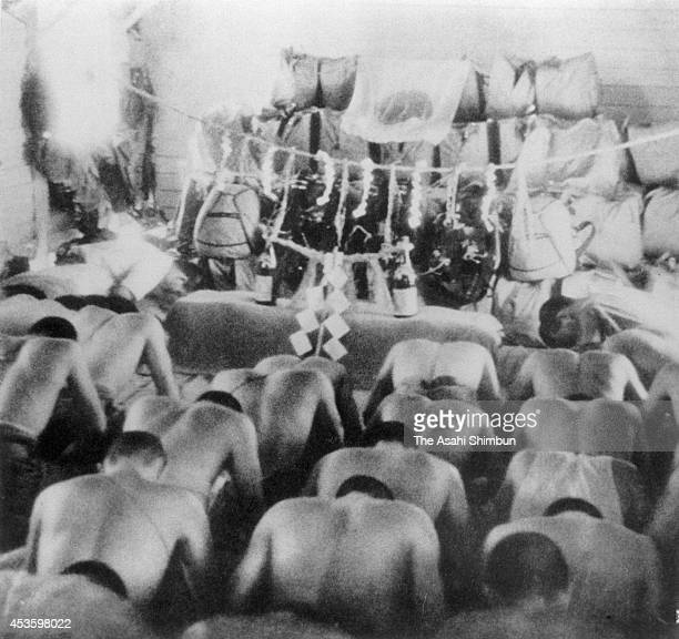 Imperial Japanese Army Air Force Paratroopers pray for the mission success ahead of the Battle of Palembang on February 14 1942