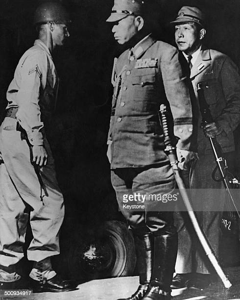 Imperial Japanese Army General General Torashiro Kawabe carrying his samurai sword arrives in Manila to surrender to the US Army Philippines 31st...