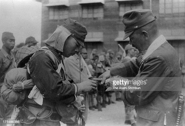Imperial Japanese Army Lieutenant Shigeo Naka is offered Japanese sake given by Emperor Hirohito by Lieutenant General Kyoji Tominaga before suicidal...