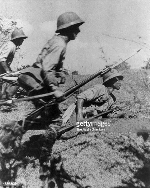Imperial Japanese Army soliders prepare at the skirt of Mt Samat during the Battle of Bataan circa April 1942 in the Philippines