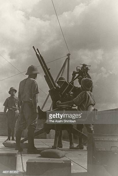 Imperial Japanese Navy Land Force operate the Type 'Ho' 13mm antiaircraft machine gun improved gun of the Hotchkiss M1929 prior to the Battle of...