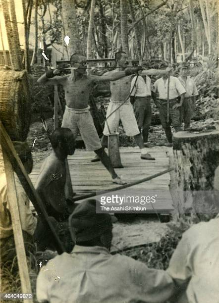 Imperial Japanese Navy soldiers take aim during an archery circa May 1942 in Truk Islands Micronesia Truk Islands was under Japanese occupation...