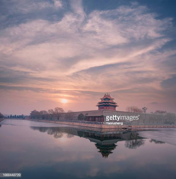 Imperial Palace over lake in the sunset in Beijing.Colorful skyline