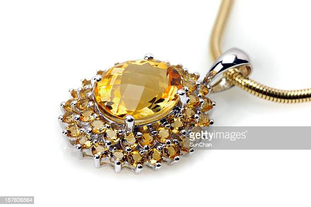 imperial topaz or citrine pendant - topaz stock photos and pictures