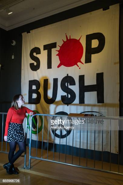 Imperial War Museum London staff views a Stop Bush banner produced by Ed Hall for a demonstration in London on November 2003 organized by Stop The...