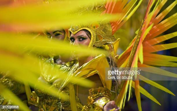 TOPSHOT Imperio Serrano samba school performers prepare before their performance on the first night of Rio's Carnival at the Sambadrome in Rio de...