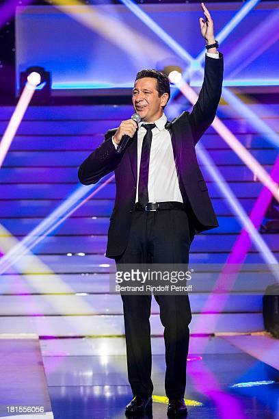 Impersonator Laurent Gerra impersonating entertainer Patrick Sebastien performs during the live broadcast on public channel France 2 of the program...