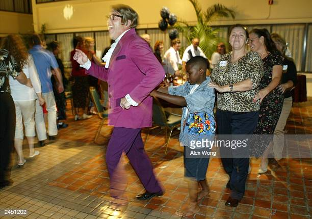 Impersonator Michael Levick who portrays Austin Powers leads a snake dance during a private birthday party at a local hotel August 30 2003 in...