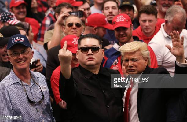 Impersonators dressed as President Donald Trump and North Korean leader Kim Jong Un gesture toward the media at a campaign rally at Las Vegas...