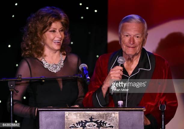 Impersonators Vera Novak of California as Sophia Loren and George Kane of Florida as Hugh Hefner present an award during The Reel Awards 2017 at the...