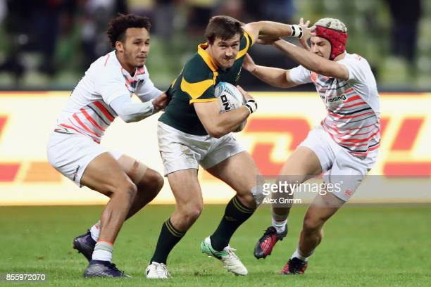 Impi Visser of South Africa is tackled by Ryan Olowofela and Mason Tonks of England during the 3rd place match between South Africa and England on...
