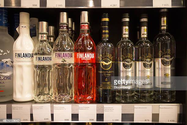 Imported bottles of Finlandia vodka of Finland stand beside bottles of Russian Beluga brand vodka in the alcohol section of an Azbuka Vkusa OOO which...