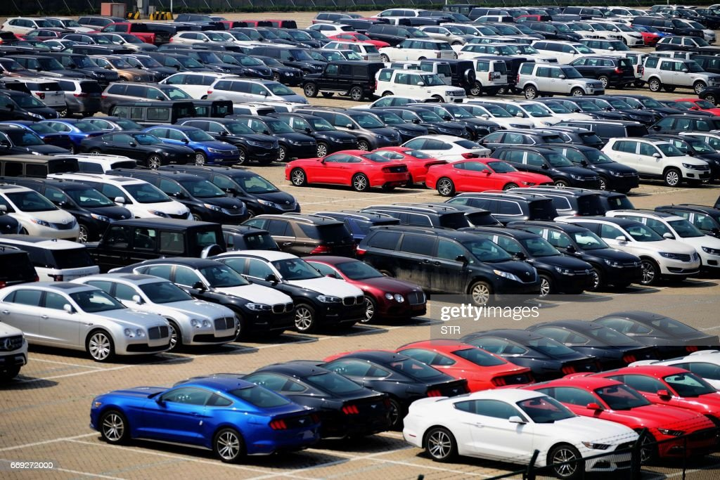 Imported Cars Are Seen Parked At A Parking Lot Near A Port In