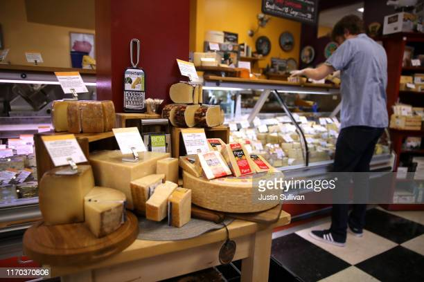 Imported Parmesan cheese is displayed at Cheese Plus on August 26 2019 in San Francisco California The United States has proposed retaliatory tariffs...
