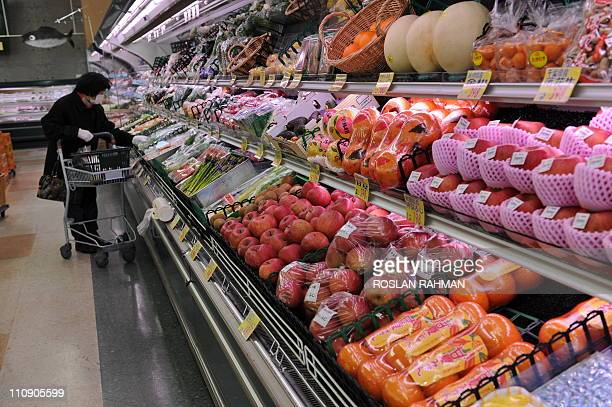 Imported vegetables and fruits filled in the freezer at a supermarket in Nihonmatsu Fukushima prefecture on March 26 2011 Lettuce contaminated with...