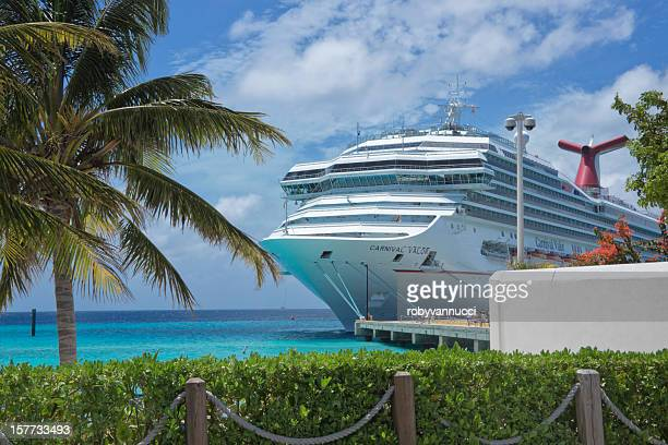 imposing carnival valor cruise ship docked at grand turk harbor - carnival cruise stock pictures, royalty-free photos & images