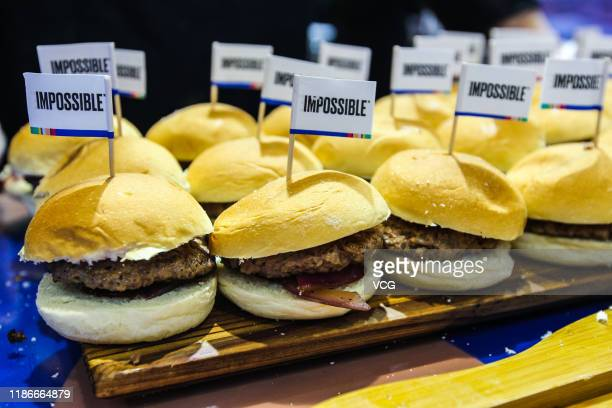 Impossible Burgers sit on a tray at the Impossible Foods Inc booth on day five of the 2nd China International Import Expo at the National Exhibition...