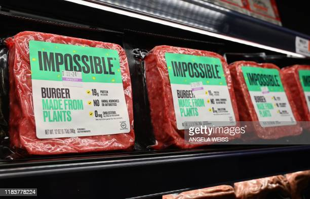 Impossible Foods burgers made from plantbased substitutes for meat products sit on a shelf for sale on November 15 2019 in New York City Vegetarian...
