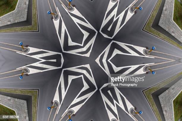 Impossible Space: digital manipulation of aerial view of a road with road markings in St. Mortiz, Switzerland