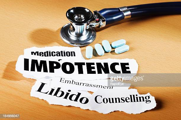 Impotence-related headlines, stethoscope and medication on doctor's desk