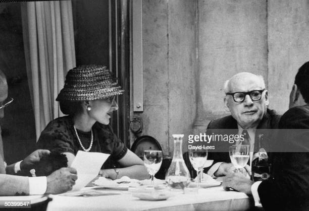 Impresario Sol Hurok sitting with opera singer Maria Callas at a dinner