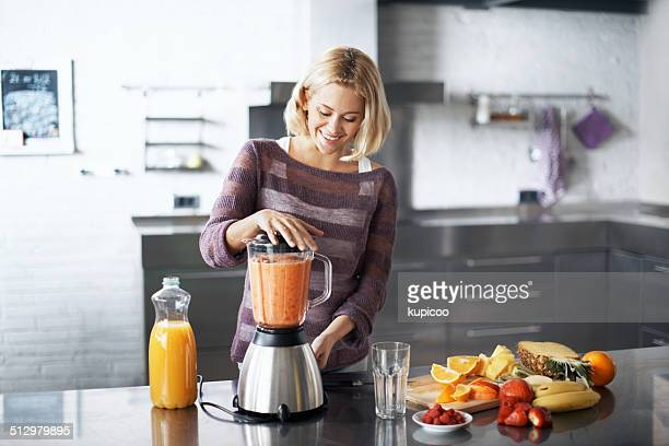 impressed with her culinary skills - appliance stock pictures, royalty-free photos & images