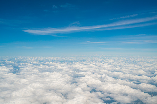 impression clouds against blue sky from airplane window - gettyimageskorea