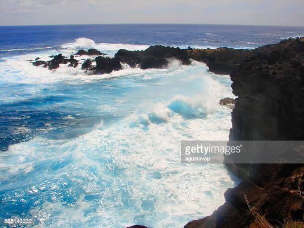 Impressive Easter Island and dramatic coastline shore: blue waves splashing on the rocks formation cliffs - Rapa Nui ancient civilization -  Idyllic pacific ocean at dramatic sunset, dramatic landscape panorama – Chile