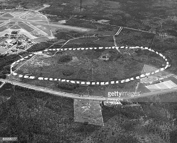 Imprints on an 8x10 glossy aerial photo show the intended footprint of the proposed Daytona International Speedway The Daytona Beach Kennel Club is...