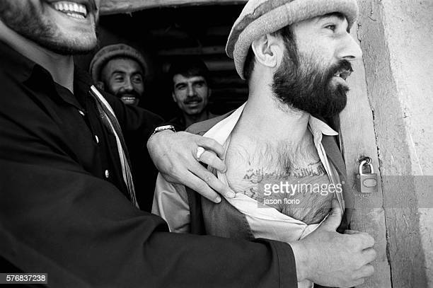 Imprisoned Taliban who has a verse from the Koran tattooed on his chest