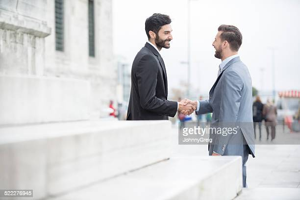 Impromptu Business Meeting  - Shaking Hands