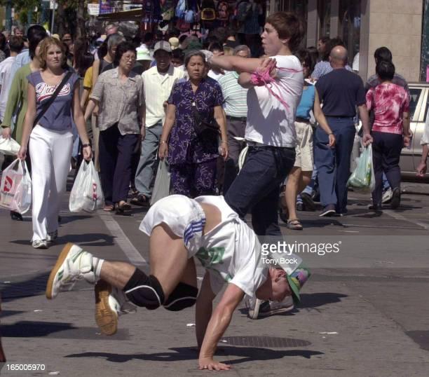 09/13/03 DANCERS Impromtu dance lessons/performance at the corner of Spadina and Dundas Dancers are Paige Gratland and John Caffery TONY BOCK/TORONTO...