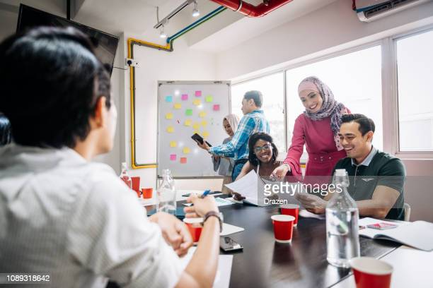 improvements in human resources in small and medium companies - malaysian culture stock pictures, royalty-free photos & images