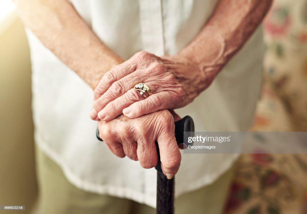 Improving mobility with a walking stick : Stock Photo