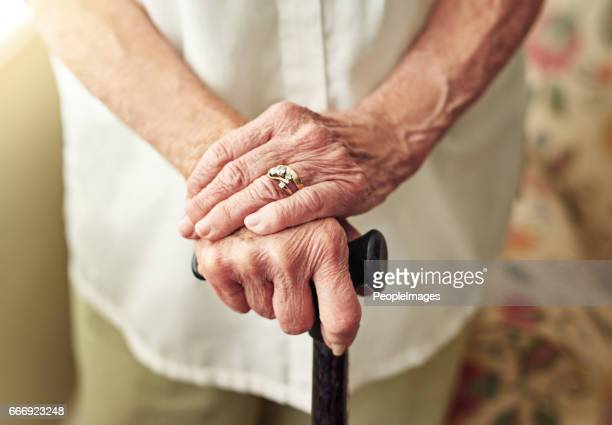 improving mobility with a walking stick - fragile sign stock pictures, royalty-free photos & images