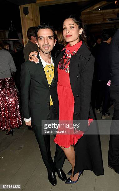 Imran Amed and Freida Pinto attend a drinks reception during the The Business of Fashion Presents VOICES on December 1 2016 in Oxfordshire England