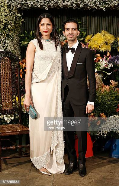 Imran Amed and Freida Pinto attend the gala dinner as The Business of Fashion Presents VOICES on December 2 2016 in Oxfordshire England