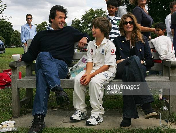Imran Khan and Jemima Khan relax with their son Suleiman Khan at the HACAN Charity Cricket Match on Ham common on July 14 2007 in Kingston upon...
