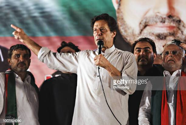 Imran Khan chairman of Pakistan TehreekeInsaf also known as Movement for Justice center speaks during a campaign rally in Lahore Pakistan on Friday...