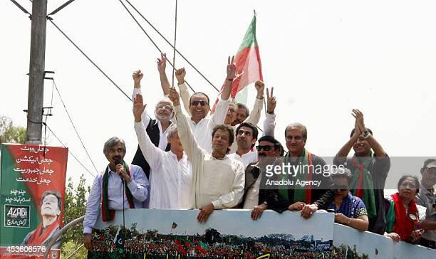 Imran Khan chairman of Pakistan TehreekeInsaf and Pakistani cricketerturnedpolitician stands with other leaders as they are heading to Islamabad to...