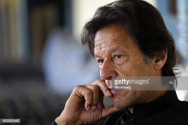 Imran Khan chairman of Pakistan TehreekeInsaf listens during an interview in Islamabad Pakistan on Saturday Dec 5 2015 India and Pakistan need...