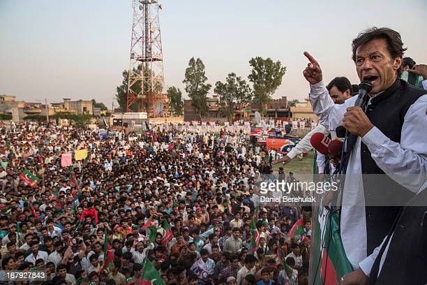 Imran Khan chairman of the Pakistan Tehreek e Insaf party addresses supporters during an election campaign rally on May 01 2013 in Narowal Pakistan...
