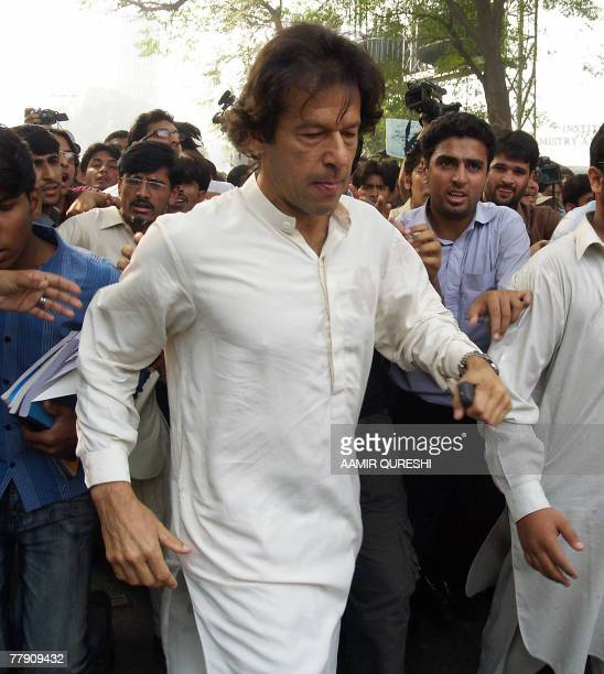 Imran Khan, cricketer turned politician is surrounded by university students in Lahore, 14 November 2007, as he appeared in public for the first time...